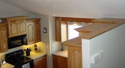 The Tops Of The Cabinets Are Finished With Red Birch Shelves Above The  Crown Molding
