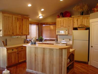 Natural Rustic Hickory Cabinetry Adorns This Custom Home